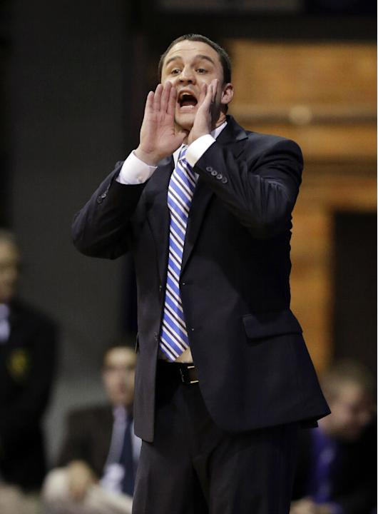 Butler head coach Brandon Miller yells to his team as they play against Manchester in the first half of an NCAA college basketball game in Indianapolis, Monday, Dec. 9, 2013