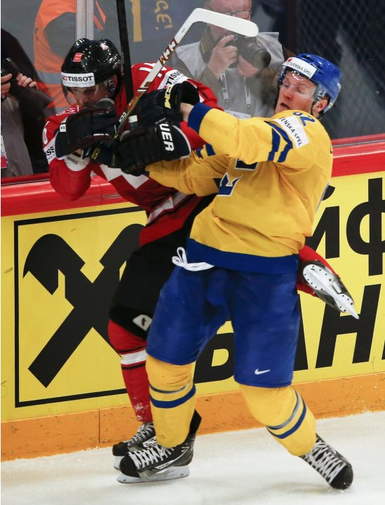 Sweden's Landeskog checks Switzerland's Diaz during their 2013 IIHF Ice Hockey World Championship final match at the Globe Arena in Stockholm