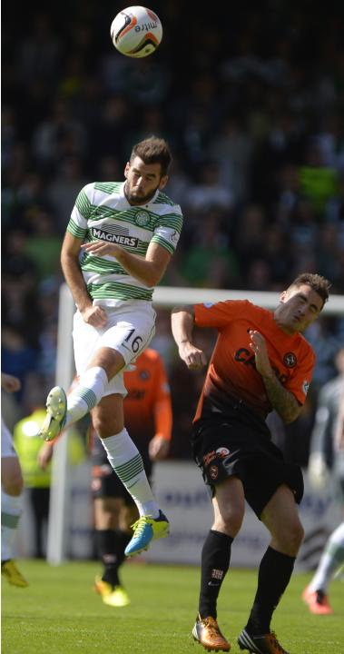 Celtic's Ledley challenges Dundee United's Paton during their Scottish Premier League soccer match in Dundee, Scotland