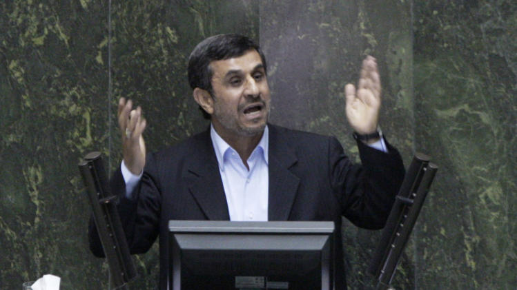 Iranian President Mahmoud Ahmadinejad answers questions in an open session in parliament in Tehran, Iran, Wednesday, March 14, 2012. Iran's parliament began on Wednesday to question President Mahmoud Ahmadinejad over a long list of accusations, including that he mismanaged the nation's economy and challenged the country's supreme leader. Ahmadinejad is the first president in the country's history to be hauled before the Iranian parliament, a serious blow to his standing in a conflict pitting him against lawmakers. (AP Photo/Vahid Salemi)