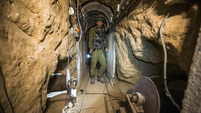 Israeli army officer gives explanations during an army organised tour in a tunnel said to be used by Palestinian militants for cross-border attacks