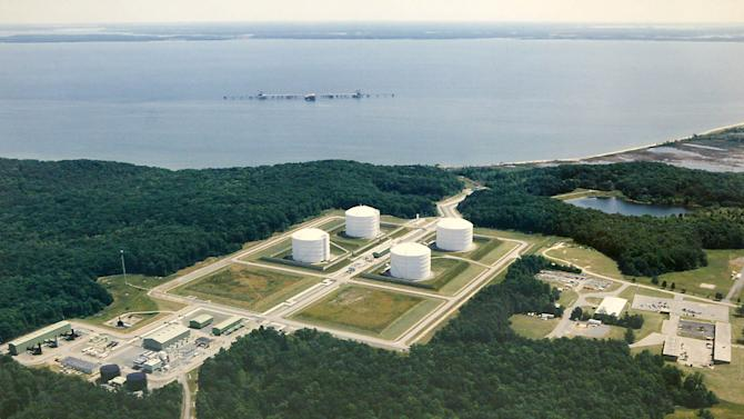 FILE- This undated aerial file photo shows the Dominion Liquified Natural Gas facility in Cove Point, Md. The Sierra Club said Thursday it will try to block an energy company's plan to export liquefied natural gas to find new markets for the drilling boom that has flooded the Mid-Atlantic with natural gas. Virginia-based Dominion Resources Inc. is seeking to export 1 billion cubic feet per day through a terminal it owns in Maryland. A previous legal settlement dating to the 1970s gives the Sierra Club the ability to reject any significant changes to the purpose or footprint of the existing natural gas terminal in Cove Point, Md., 60 miles southeast of Washington. (AP Photo/ Matt Houston, File)