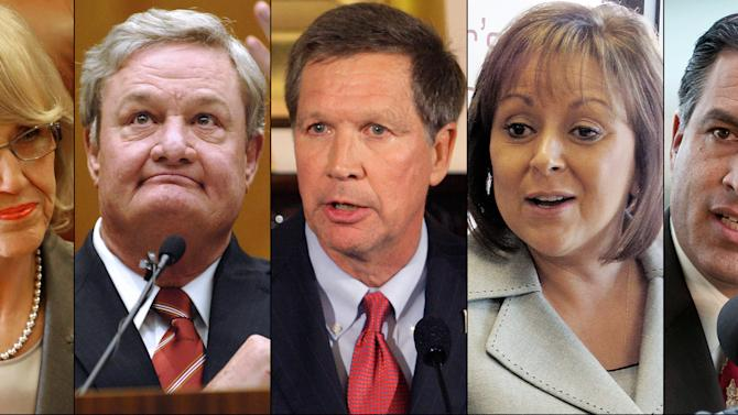 FILE - This combination of undated file photos shows Republican Governors, from left: Jan Brewer, Ariz.; Jack Dalrymple, N.D.; John Kasich, Ohio; Susana Martinez, N.M., and Brian Sandoval, Nev. While far from voicing a consensus opinion in their party, the governors, along with Michigan Gov. Rick Snyder, are six GOP governors who in the past two months who have joined a growing number of Republican governors now buying into parts of the system as the financial realities of their states' medical costs begin to counterbalance the fierce election politics of the issue. (AP Photo/File)