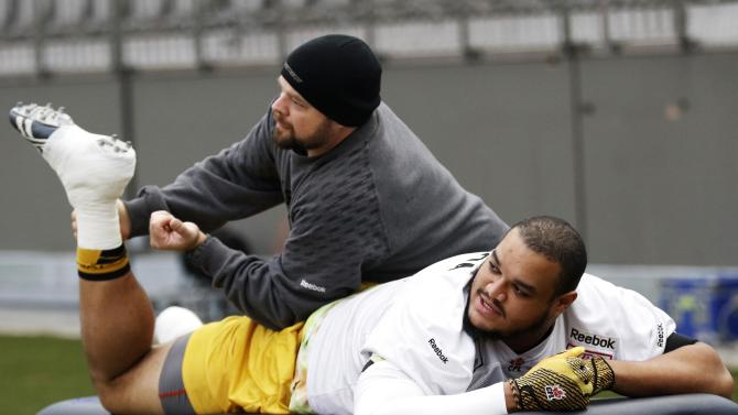 Hamilton Tiger-Cats Figueroa is worked on by a team trainer during their team's practice at the CFL's 102nd Grey Cup week in Vancouver