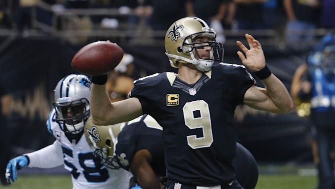 New Orleans Saints quarterback Drew Brees (9) passes under pressure from Carolina Panthers outside linebacker Thomas Davis (58) in the first half of an NFL football game in New Orleans, Sunday, Dec. 8, 2013. (AP Photo/Bill Haber)