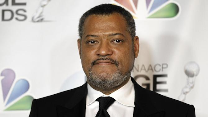 "FILE - In this Feb. 17, 2012 file photo, Laurence Fishburne, winner of the awards for outstanding actor in a television movie, mini-series or dramatic special and outstanding television movie, mini-series or dramatic special for ""Thurgood"" poses backstage at the 43rd NAACP Image Awards in Los Angeles.  Court records show Fishburne was granted a temporary restraining order on Thursday Jan. 3, 2012 against a man who claims to own the actor's house and went there on New Year's day to try to evict him and his family. Fishburne's filing states police told him that the man was recently released from parole for a previous cyberstalking and criminal threats conviction. (AP Photo/Matt Sayles, File)"