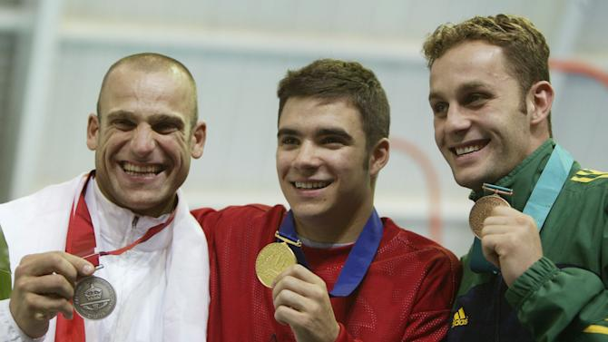 Tony Ally of England (L), Alexandre Despatie of Canada (M) and Robert Newbery of Australia with their medals during the 2002 Commonwealth Games in Manchester, England