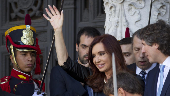 Argentina's President Cristina Fernandez, center, waves to supporters as she leaves the Argentine National Congress where she inaugurated the opening legislative session, in Buenos Aires, Argentina, Friday, March 1, 2013. Vice President Amado Boudou is pictured on far right. (AP Photo/Victor R. Caivano)