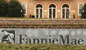 A man stands outside Fannie Mae in Washington