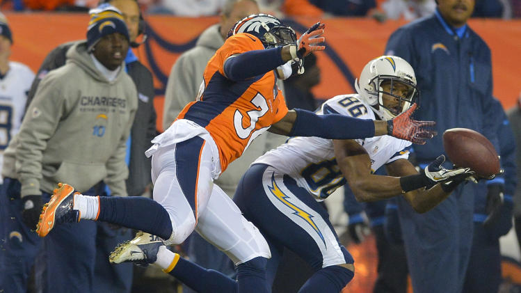 San Diego Chargers wide receiver Vincent Brown (86) catches a pass against Denver Broncos cornerback Kayvon Webster (36) in the third quarter of an NFL football game, Thursday, Dec. 12, 2013, in Denver