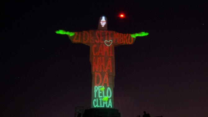 "Christ the Redeemer statue is lit up with the words that read in Portuguese ""21 September, March for the Climate,""  in Rio de Janeiro, Brazil, Thursday, Sept.18, 2014. The statue was lit up in as a symbolic warning to the dangers of climate change. This event is in support of the Global People's Climate March, scheduled for the next Sunday, which is asking for solutions to combat global climate change, in advance of the United Nations Climate Summit to be held on September 23. (AP Photo/Silvia Izquierdo)"