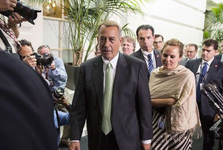 File photo of Speaker of the U.S. House Boehner being followed by reporters after a Republican caucus meeting at the Capitol in Washington