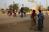 "Local youngsters are seen playing basketball at the former ""Sharia Square"" in central Gao, on February 26, 2013. Since the departure of the Islamists, who occupied the city for nine months, following the arrival of the French and Malian forces, the central square of Gao is once again called ""Independence square."""