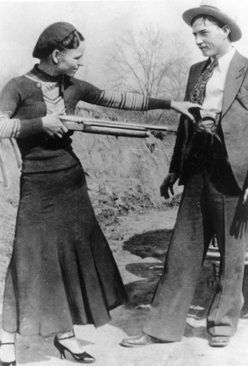 FILE - This this undated file photo shows outlaws and lovers Bonnie Parker, left, and Clyde Barrow.  Guns and other items connected to the couple are going on auction by RR Auction of Amherst, N.H.  A