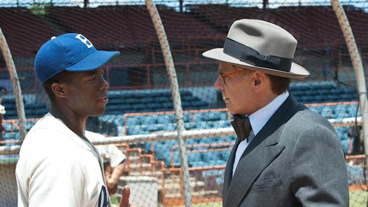 "This film image released by Warner Bros. Pictures shows Chadwick Boseman as Jackie Robinson, left, and Harrison Ford as Branch Rickey in a scene from ""42."" (AP Photo/Warner Bros. Pictures, D. Stevens)"