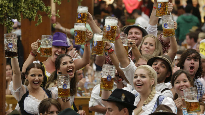 "Young people enjoy the opening ceremony of the famous Bavarian ""Oktoberfest"" beer festival in Munich, southern Germany, Saturday, Sept. 22, 2012. The world's largest beer festival, to be held from Sept. 22 to Oct. 7, 2012 will see some million visitors. (AP Photo/Matthias Schrader)"