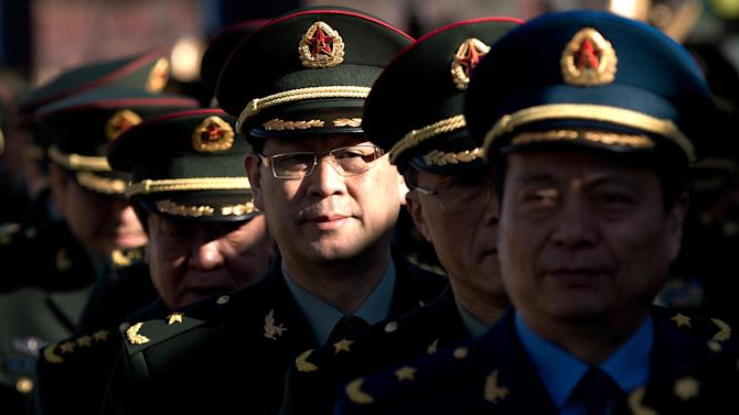 Delegates from the Chinese People's Liberation Army (PLA) line up as they arrive for a session of the National People's Congress and the Chinese People's Political Consultative Conference held at the Great Hall of the People in Beijing Monday, March 4, 2013. In a rare move, China on Monday declined to reveal its defense budget request for 2013. It has been customarily that the country announces its defense spending plan for a new year at a press conference that is held a day before the opening of an annual session of the National People's Congress, China's parliament. (AP Photo/Andy Wong)