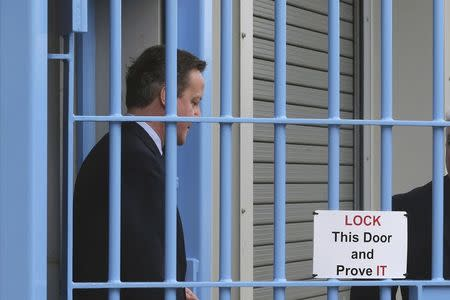 Britain's Prime Minister David Cameron tours HMP Onley in Rugby, central England