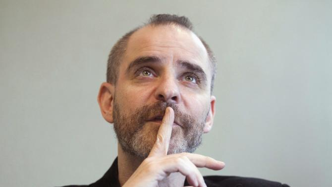 FILE - This Sept. 16, 2010 photo shows author David Rakoff during an interview in Toronto. Rakoff, an award-winning humorist whose cynical outlook on life and culture developed a loyal following of readers and radio listeners, died Thursday, Aug. 9, 2012, after a long illness, Doubleday and Anchor Books announced. The statement did not detail a cause of death, but Rakoff had been open about his battles with cancer. (AP Photo/The Canadian Press, Frank Gunn)