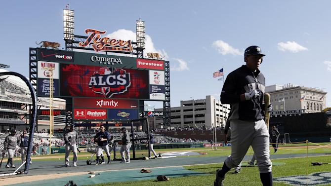 New York Yankees' Alex Rodriguez runs back to the dugout after batting practice before Game 4 of the American League championship series against the Detroit Tigers Thursday, Oct. 18, 2012, in Detroit. (AP Photo/Paul Sancya )