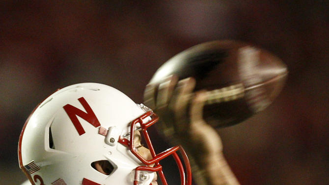 Nebraska quarterback Taylor Martinez (3) passes against Wisconsin during the first half of an NCAA college football game Saturday, Oct. 1, 2011, in Madison, Wis. (AP Photo/Andy Manis)