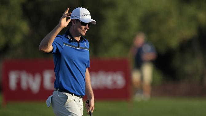 Rose of England waves on the 18th green during the third round of the DP World Tour Championship in Dubai