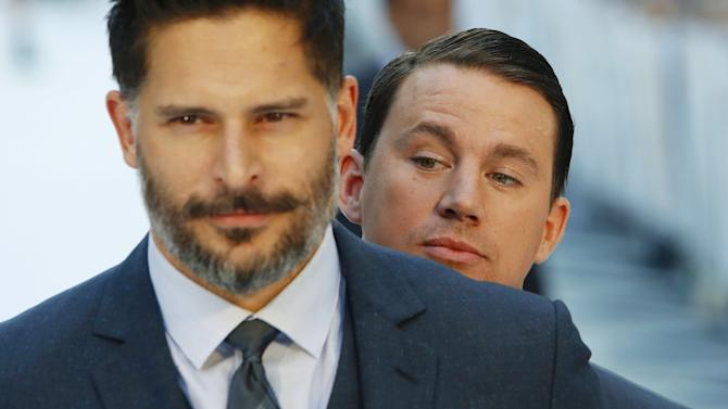 """Actor Channing Tatum photo-bombs Joe Manganiello as he poses at the European premiere of """"Magic Mike XXL"""" at Leicester Square in London, Britain"""