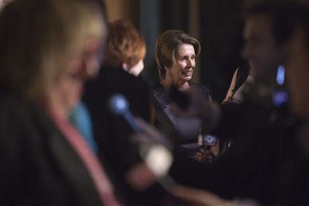 Pelosi talks to reporters as she arrives on the red carpet before the 2013 Mark Twain Prize for American Humor presentation to Burnett at the Kennedy Center in Washington