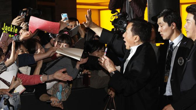 Hong Kong actor and director Jackie Chan, third from right, and South Korean actor Kwon Sang-woo, right, are greeted by fans during a promotional event for their latest movie, CZ12, or Chinese Zodiac, in Seoul, South Korea, Monday, Feb. 18, 2013. (AP Photo/Ahn Young-joon)