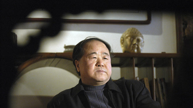 In this photo taken on Tuesday, Dec. 27, 2005, Chinese writer Mo Yan listens during an interview in Beijing, China. Mo was awarded the Nobel Prize in literature during a ceremony in Sweden on Thursday, Oct. 11, 2012. (AP Photo) CHINA OUT