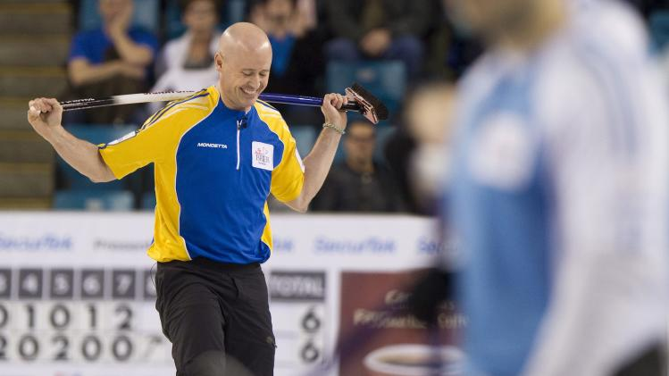 Team Alberta skip Kevin Koe reacts after throwing a rock in eighth end against team Quebec during the semi-final draw at the 2014 Tim Hortons Brier curling championships in Kamloops, British Columbia