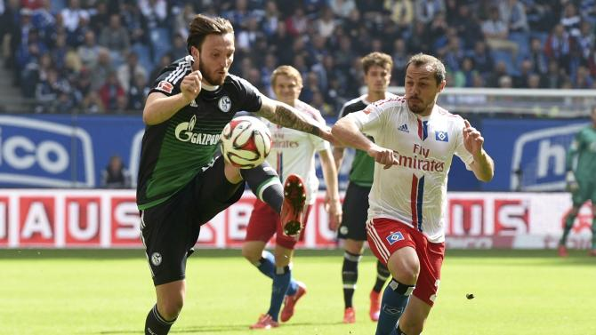 Schalke 04's Hoegerfights for the ball with Hamburg SV's Diaz during their German Bundesliga first division soccer match in Hamburg