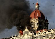 Flames gushing out of The Taj Mahal Hotel in Mumbai, one of the sites attacked by militant gunmen, in November 2008. India's Supreme Court on Wednesday confirmed the death sentence handed down to Mohammed Kasab, the lone surviving gunman from the 2008 Mumbai attacks in which 166 people were killed