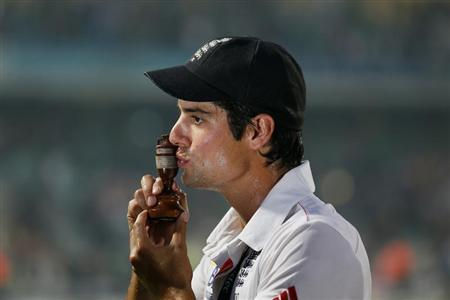 England's captain Alastair Cook kisses the replica Ashes urn after the fifth Ashes test cricket match against Australia ended in a draw and England won the series 3-0 at the Oval cricket ground in Lon