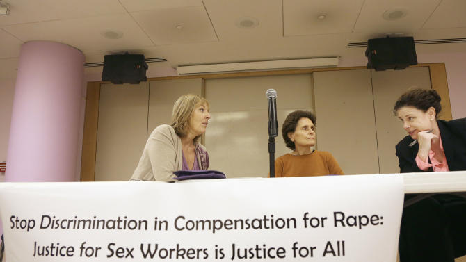 Maxine Doogan of the Erotic Service Providers Union, from left, Rachel West of the US PROStitutes Collective and Kimberly Horiuchi, spokesperson for the ACLU on victim compensation talk before a meeting with others who claim that the California Victims Compensation Board discriminates against sex workers by denying them benefits after having been raped in San Francisco, Tuesday, Nov. 12, 2013. (AP Photo/Jeff Chiu)