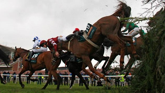 Always Right ridden by James Reveley falls at the Chair during the Grand National Steeple Chase at Aintree, northern England