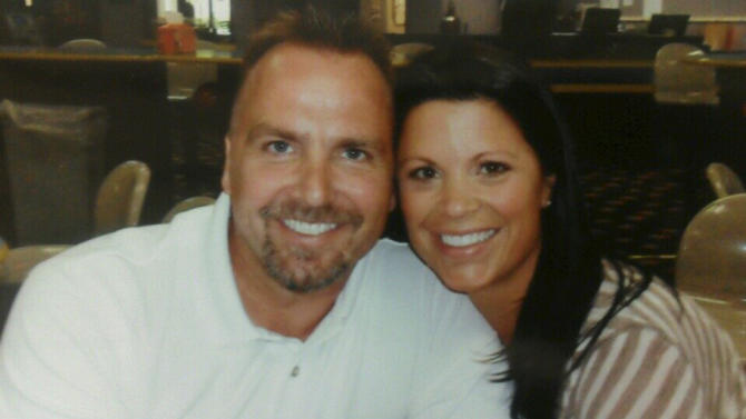 This undated photo provided by Mike Archambault shows Brian Vander Lee, 43, of Ramsey, left, and his wife, Kourtney Vander Lee. Brian Vander Lee is hospitalized after he was allegedly punched by an off-duty Minneapolis police sergeant and SWAT officer on Saturday night. Minneapolis police Sgt. David Clifford was charged with third-degree assault and was released Tuesday after posting $15,000 bail. (AP Photo/Courtesy Mike Archambault)