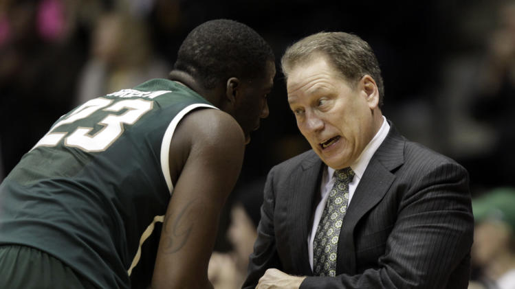 Michigan State head coach Tom Izzo, right, shakes hands with forward Draymond Green shortly before Green left the game while playing Purdue in the second half of an NCAA college basketball game in West Lafayette, Ind.  Sunday, Feb. 19, 2012. Michigan State won 76-62. (AP Photo/AJ Mast)