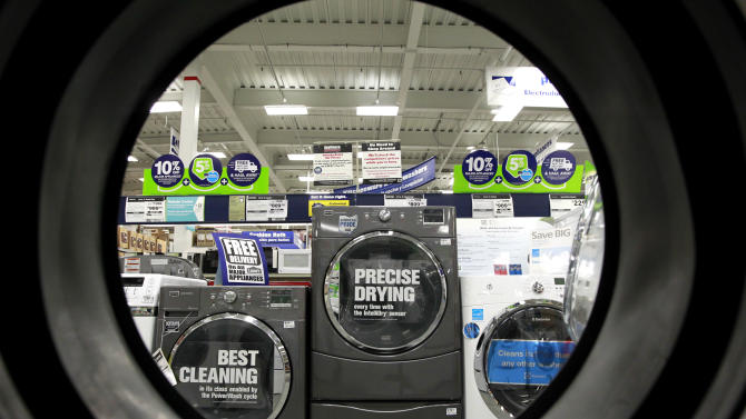 FILE - In this Monday, Sept. 10, 2012 file photo, dryers are seen from the inside of another clothes' dryer, foreground, at a Lowe's store location, in Framingham, Mass. Lowe's Cos. Inc. reports quarterly financial results before the market opens on Wednesday, Nov. 20, 2013. (AP Photo/Steven Senne, File)