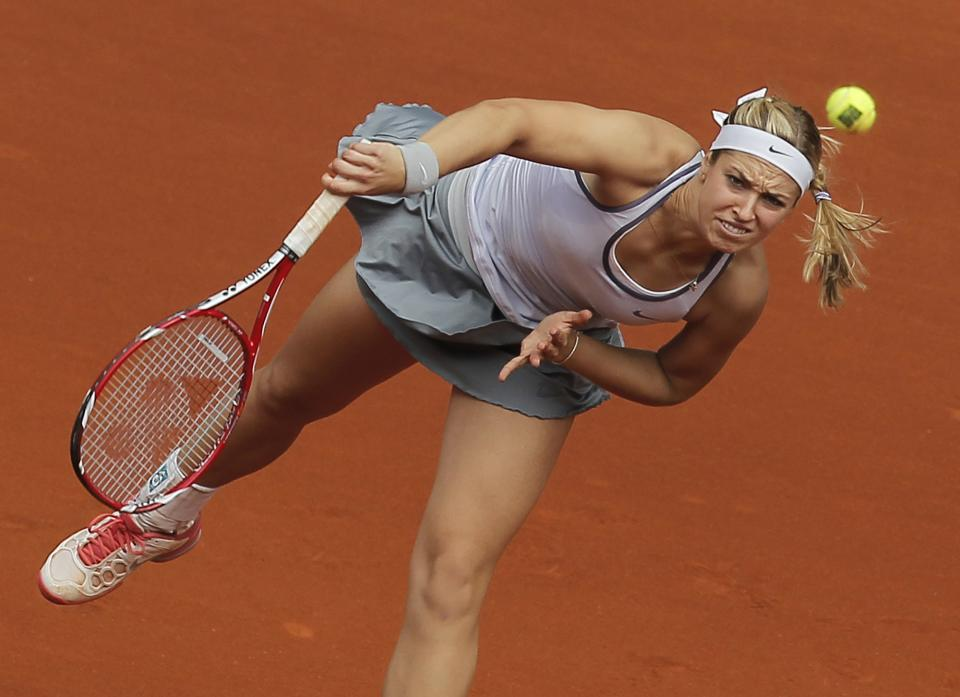 Sabine Lisicki from Germany serves during the match against Maria Sharapova from Russia at the Madrid Open tennis tournament, in Madrid, Thursday, May 9, 2013. (AP Photo/Andres Kudacki)