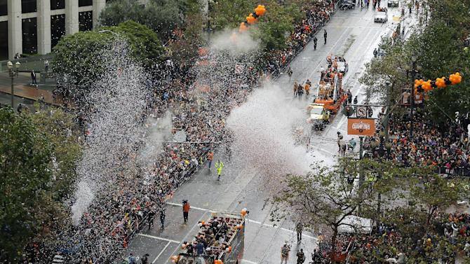 San Francisco Giants players ride in double decker buses during the victory parade for baseball's 2014 World Series Champion San Francisco Giants on Friday, Oct. 31, 2014 in San Francisco. (AP Photo/Eric Risberg)