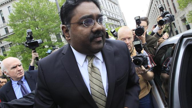 FILE - In this May 11, 2011 file photo, Raj Rajaratnam, billionaire co-founder of Galleon Group, is surrounded by photographers as leaves Manhattan federal court with his attorney Terence Lynan, left, in New York. Rajaratnam, the former Wall Street titan convicted of making a fortune by coaxing a crew of corporate tipsters to give him an illegal edge on blockbuster trades in technology and other stocks, is scheduled to be sentenced Thursday, Oct. 13, 2011 for his conviction at trial earlier this year. (AP Photo/Mary Altaffer, File)