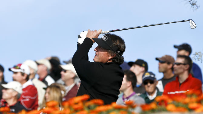 Phil Mickelson tees off on the 12th hole during the first round of the Waste Management Phoenix Open golf tournament Thursday, Jan. 31, 2013, in Scottsdale, Ariz.(AP Photo/Ross D. Franklin)