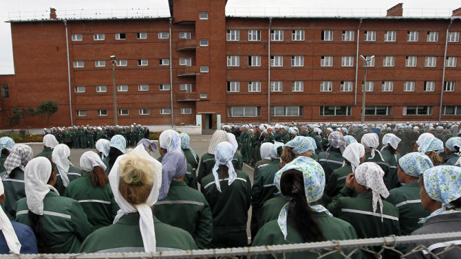 In this photo taken Aug. 22, 2012, inmates stand during a morning inspection at a women's prison in Sarapul, central Russia. Mark Feygind, a lawyer for the two jailed Pussy Riot band members said Monday, Oct. 22, 2012, that Maria Alekhina and Nadezhda Tolokonnikova were transferred during the weekend from Moscow prison, where they were kept since March. Feygin said prison authorities informed him that Alekhina had been sent to the Perm region in the Urals and Tolokonnikova to the central province of Mordovia.  (AP Photo/Yuri Tutov)