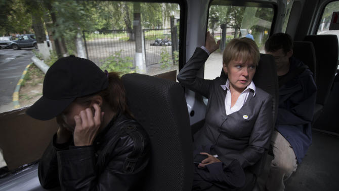 In this Thursday, Aug. 23, 2012 photo, Yevgenia Chirikova speaks to her colleagues while she rides the minibus in Khimki, outside Moscow. When the young mother of two embarked on her small and private campaign to save a forest in her town just outside Moscow, she had no clue that in order to gain the upper hand in this battle she would need to launch a nationwide campaign, hold a thousand-strong rally and ultimately run for mayor of that town. Environmental activist Yevgeniya Chirikova, a driving force behind a movement to save the forest in Khimki, is now running for mayor of that town which, thanks largely to her efforts, became one of the first battlegrounds of the anti-Kremlin protests. The Khimki vote could prove the first major electoral test for authorities and the opposition since the anti-Putin protests.  (AP Photo/Sergey Ponomarev)