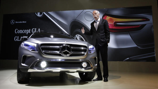 "Dieter Zetsche, chairman of Daimler AG, unveils Mercedes-Benz new concept car ""GLA"" during a press conference ahead of the Shanghai International Automobile Industry Exhibition (AUTO Shanghai) in Shanghai, China Friday, April 19, 2013. (AP Photo/Eugene Hoshiko)"