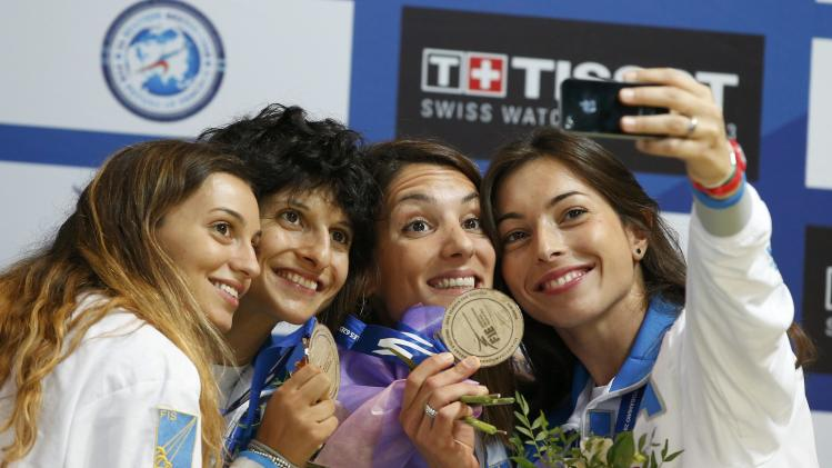 Team Italy Fiamingo, Quondamcarlo, Del Carretto, and Navarria pose with their in the bronze medals for the women's team epee at the World Fencing Championships in Kazan