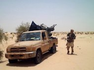 An Islamists rebel of Ansar Dine is pictured near Timbuktu, in April 2012. Mali&#39;s embattled transitional government has rejected a rebel alliance&#39;s declaration of an Islamic state in the vast desert north, a move that has plunged the nation closer to breakup two months after a coup