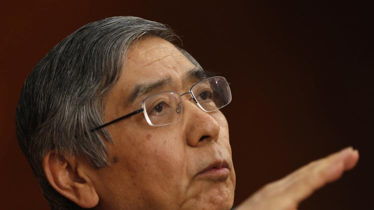 Bank of Japan Governor Kuroda gestures as he speaks during a news conference at the BOJ headquarters in Tokyo
