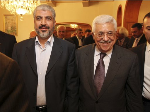 Hamas leader Khaled Meshaal walks next to Palestinian President Mahmoud Abbas after their meeting in Cairo